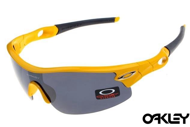 oakley radar pitch sunglasses in polished yellow and black iridium