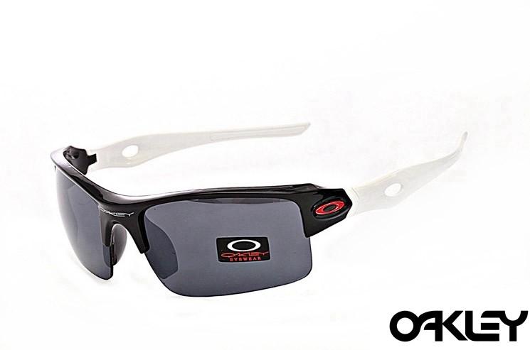 Oakley sunglasses in polished black and white and black iridium