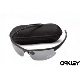 Oakley sunglasses in matte black and clear black iridium