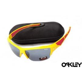 Oakley sunglasses in matte yellow and black iridium